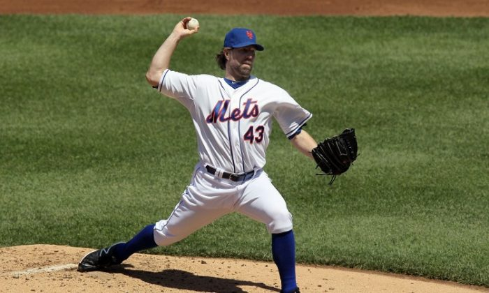 Mets starter R.A. Dickey went six innings allowing four earned runs, while striking out eight Reds. (Jim McIsaac/Getty Images)