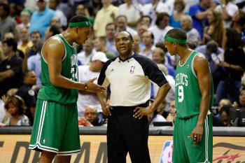 REFEREE INTERFERENCE: Paul Pierce (left) and Rajon Rondo question referee Eddie Rush. (Doug Benc/Getty Images)