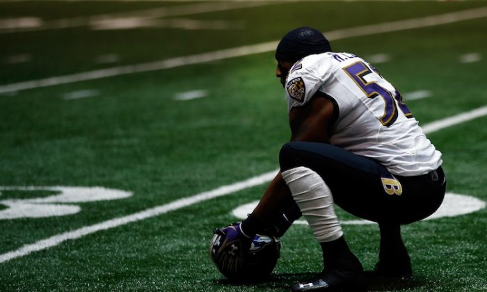 Ray Lewis and the Ravens watched their momentum slip away during the 34-minute power outage, only to make a last-second defensive stand to wrap up the Super Bowl. (Chris Graythen/Getty Images)