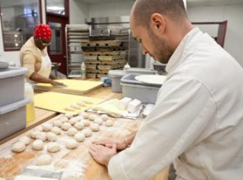 Peter Andriss (R) and Marie A. Poisson (L) have worked with Hot Bread Kitchen. (Amal Chen/The Epoch Times)