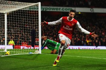 Arsenal's Robin van Persie scored all of his team's goals in a convincing victory over Wigan on Saturday.  (Mike Hewitt/Getty Images)
