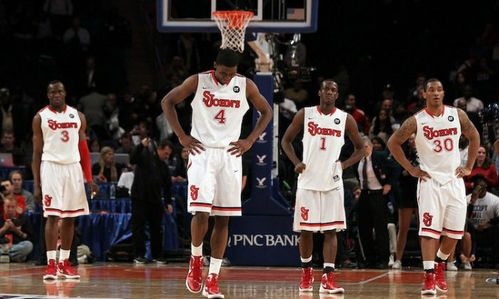 Red Storm players (L-R) God'sgift Achiuwa, Moe Harkless, Phil Greene, and Jamal White appear tired late in the game Tuesday. (Jim McIsaac/Getty Images)