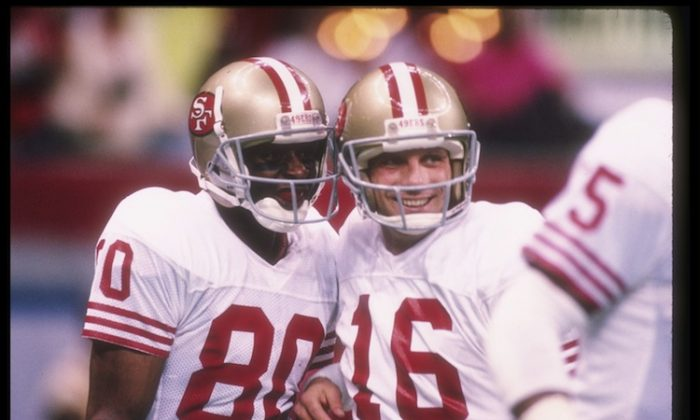 After Jerry Rice (L) and Joe Montana (R) put on a show in Super Bowl XXIV, the only suspense in the second half was which of the two would win MVP honors. (Rick Stewart/Getty Images)