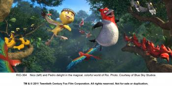 FREEDOM FLIGHT: (L-R) Nico (Jamie Foxx) and Pedro (will.i.am) delight in a magical, colorful world in the 3-D animation 'Rio.' (Blue Sky Studios and Twentieth Century Fox Film Corporation)