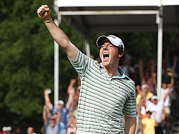 Rory McIlroy celebrates as he holes a birdie putt on the 18th green to secure victory during the final round of the 2010 Quail Hollow Championship. (Scott Halleran/Getty Images)