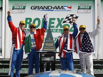 CELEBRATION AT LAST: Drivers of the 01 Telmex Ganassi BMW Riley (from L): Graham Rahal, Memo Rojas, Scott Pruett, and Joey Hand celebrate after winning the Rolex 24. (Chris Graythen/Getty Images )