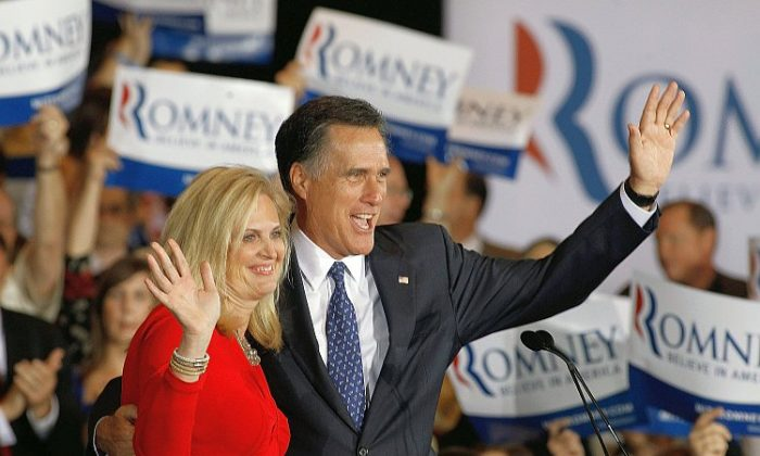 Republican presidential candidate, former Mass. Gov. Mitt Romney and his wife Ann Romney celebrate their victory in the Illinois GOP primary at the Renaissance Schaumburg Convention Center Hotel, March 20 in Schaumburg, Ill. Exit polls showed Romney leading his closest rival, former Sen. Rick Santorum (R-Penn.), and will keep his lead in the delegate count. (Chip Somodevilla/Getty Images)
