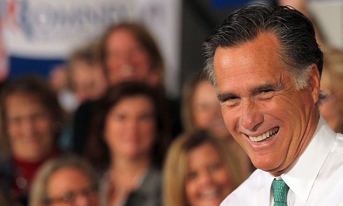 Republican presidential candidate and former Massachusetts Gov. Mitt Romney laughs as he speaks to supporters last week in Connecticut. With chief rival Santorum out of the race, the former Massachusetts governor is now the presumptive Republican nominee. (Spencer Platt/Getty Images)