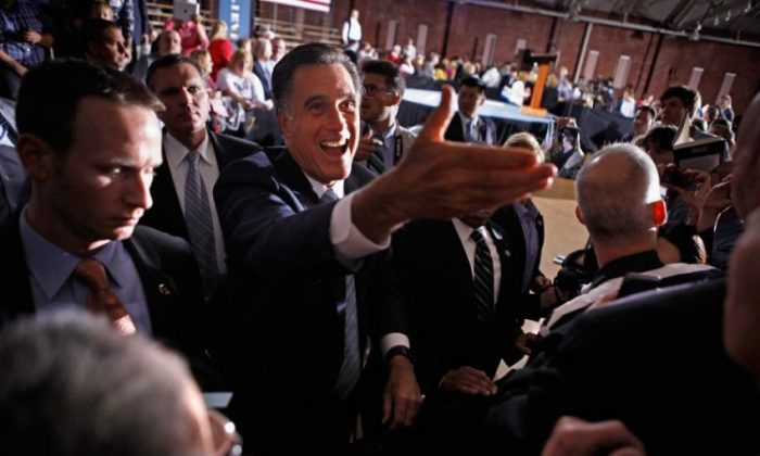 epublican presidential candidate former Massachusetts Gov. Mitt Romney shakes hands with supporters during a campaign rally at the Radisson Hotel in Manchester, N.H., on Tuesday. (Chip Somodevilla/Getty Images)