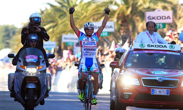 Miguel Rubiano celebrates crossing the finish line of the Stage Six of the Giro d'Italia. (Luk Beines/AFP/GettyImages)