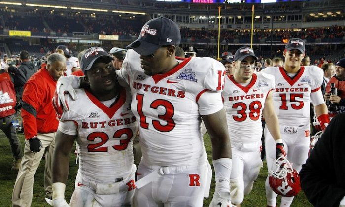 Rutgers' players Jawan Jamison (23) and Ka'Lial Glaud (13) will have a new coach next season. (Jeff Zelevansky/Getty Images)