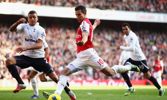 Arsenal's Theo Walcott scored two goals to put the game out of Tottenham's reach. (Clive Mason/Getty Images)