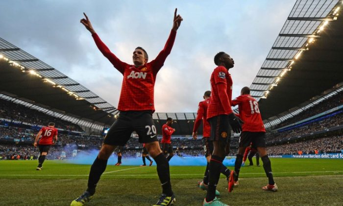 Wayne Rooney (R) is congratulated by Robin van Persie after scoring Manchester United's opening goal at Etihad Stadium in the Manchester derby on Sunday, Dec. 9, 2012.