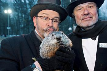 Punxsutawney Phil Poses: Two members of Phil's Inner Circle bask in the prognosticating rodent's glory, upon his emergence at Gobbler's Knob in Feb. 2010. (Jan Jekielek/The Epoch Times)