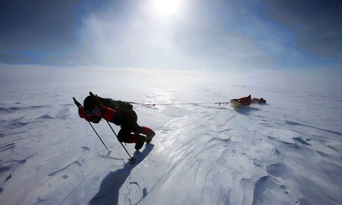Sebastian Copeland pulls his double sleigh loaded with the 400 pounds of provisions he needs for his historic 81-day trek across the Antarctic. (Courtesy of Sebastian Copeland)