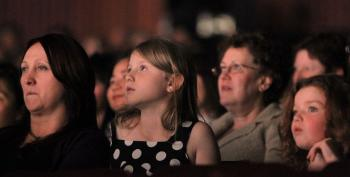 ENTRANCED: Two little girls are mesmerized by the performance of Shen Yun, in Melbourne, Australia, on May 25.  (Ming Chen/Epoch Times)