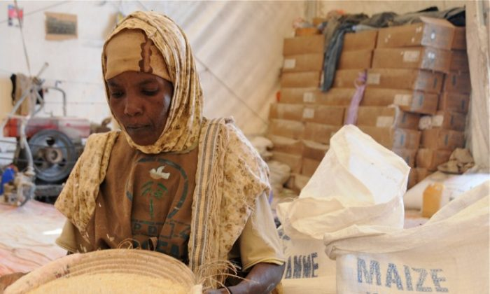 Woman in front of sacks with maize in Mogadishu, Somalia, August 2011. (WFP/David Orr)