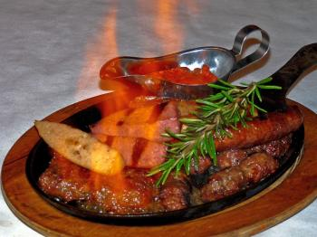 SAUSAGE FLAMBE: Sausage and spice and everything nice. The incredible sausage Flambe. (Nadia Ghattas/Epoch Times )