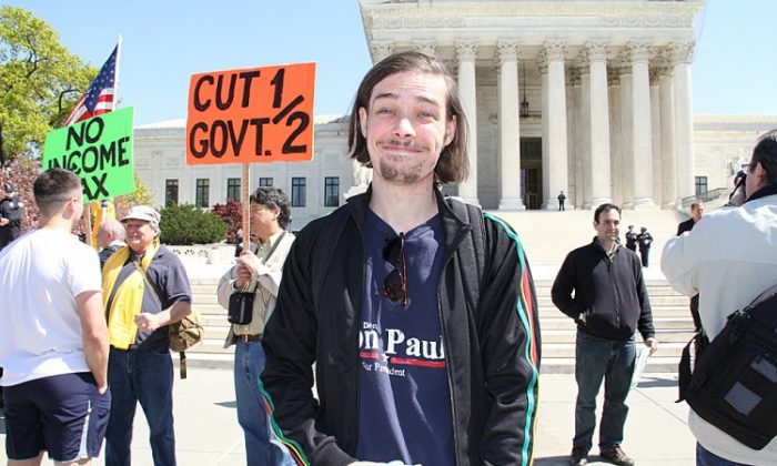 Outside the courtroom, opponents of the ACA protested at a rally on Tuesday. (Shar Adams/The Epoch Times)