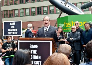 Manhattan Borough President Scott Stringer speaks to a cheering crowd during a rally to save the Garment Center on October 21 in front of the landmark Button and Needle Statue. (Joshua Philipp/The Epoch Times)