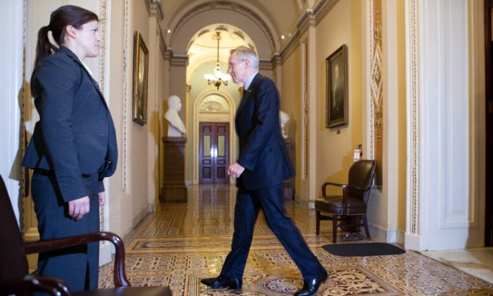 Senate Majority Leader Harry Reid (D-NV) returns to his office after reaching a deal on the federal budget in April 2011. Leaders barely averted a government shutdown last spring. (Brendan Hoffman/Getty Images)