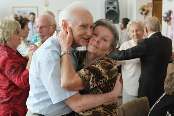 An elderly couple embrace while dancing during an afternoon get-together at a senior care home in this file photo. The 2010 census data reveals that the population of 65 and older Americans is higher than its ever been. (Sean Gallup/Getty Images)