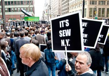 A man holds a placard stating 'It's Sew N.Y.' during a rally to save Manhattan's Garment Center on October 21 on 39th Street and 7th Avenue.  (Joshua Philipp/The Epoch Times)