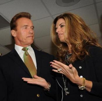 California Gov. Arnold Schwarzenegger and his wife Maria Shriver during a Global Climate Summit this month in Los Angeles. California's first lady was photographed holding her cellphone to her ear while driving, violating a state's law signed by her husband. (Mark Ralston/AFP/Getty Images)