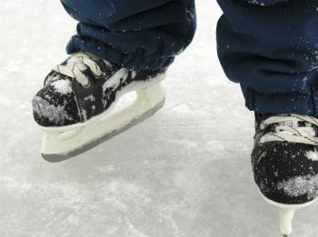 As the winter sets in, ice skating is a favorite pastime that also won't cost you a lot of money. If you plan to enjoy ice skating on a pond or lake, be sure to check with local authorities to ensure it is safe. (Photos.com)