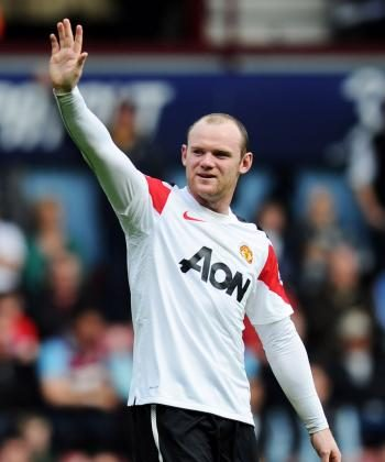 HAT-TRICK WINNER: Superstar Wayne Rooney of Manchester United celebrates his hat-trick during the Barclays Premier League match between West Ham United and Manchester United at the Boleyn Ground on April 2, 2011 in London, England. (Mike Hewitt/Getty Images)
