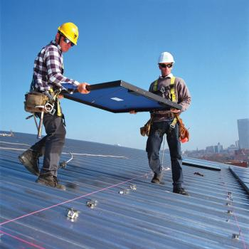 Installing solar panels on a roof in Atlanta, Georgia. (National Renewable Energy Lab)