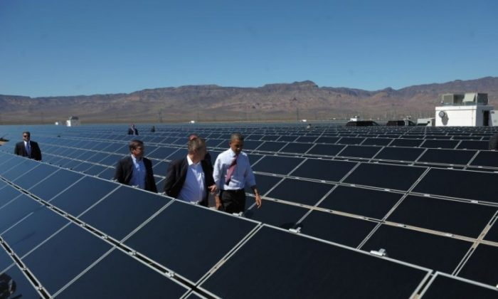 President Barack Obama (C) tours the Copper Mountain Solar Project, the largest photovoltaic plant operating in the country, March 21 in Boulder City, Nev. (Mandel Ngan/AFP/Getty Images)