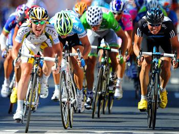 Mark Cavendish (L) sprints on the finish line ahead of Gerald Ciolek (2L) and Edvald Boasson Hagen (R) of Stage Five of the 2010 Tour de France. (Pascal Pavani/AFP/Getty Images)