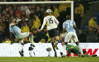 VALUABLE GOAL: Peter Crouch scores the game's only goal as Tottenham grab a precious victory at Manchester City. (IAN KINGTON/AFP/Getty Images)