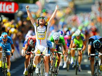 Mark Cavendish (C) celebrates on the finish line after winning Stage Five of the 2010 Tour de France. (Pascal Pavani/AFP/Getty Images)