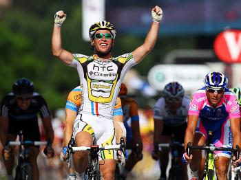 Mark Cavendish celebrates winning Stage Six of the 2010 Tour de France. (Bryn Lennon/Getty Images)