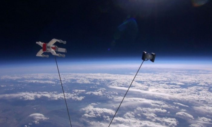 "Toy models of an X-Wing and a Tie Fighter from the ""Star Wars"" films, built from LEGOs, are shown at the edge of space. (JP Aerospace)"