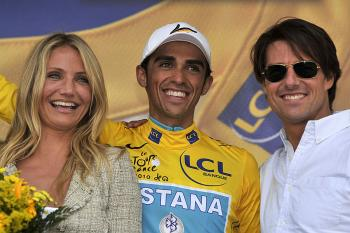 Alberto Contador poses with Cameron Diaz (L) and Tom Cruise (R) on the podium at the end of Stage 18 of the 2010 Tour de France. (Lionel Bonaventure/AFP/Getty Images)
