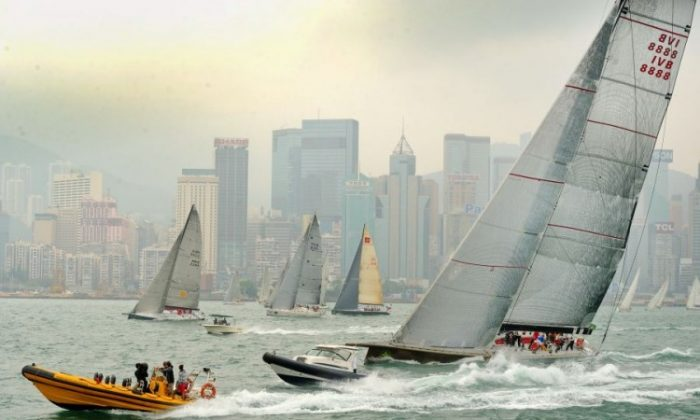 Flying start ... 'Genuine Risk' (foreground) took an early lead in the Rolex China Sea Race 2012. The 90-foot maxi is seen here after crossing the start line in Victoria Harbour, offshore from the Royal Hong Kong Yacht Club, on Wednesday afternoon, April 4.( Sung Bilung/The Epoch Times)