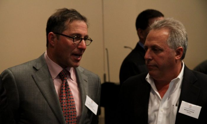 Bob Sanna, executive vice president at Forest City Ratner Companies, which is constructing Barclay's Center in Brooklyn, speaks with Michael Pintchik, president of Pintchik, on Tuesday at the Brooklyn Real Estate Roundtable. (Zachary Stieber/The Epoch Times)