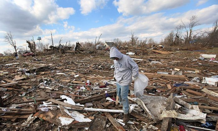 Tony Sherrard searches for family keepsakes through debris that used to be his home on March 3 in Marysville, Ind. Dozens of people were killed as severe weather and tornadoes ripped through the South and Midwest on Friday. (Scott Olson/Getty Images)