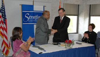 Dr. Richard R. Shurtz, II and Mr. K. K. Modi shake hands at Stratford University's main campus in Falls Church, Virginia on Oct. 1. (Courtesy of Stratford University)