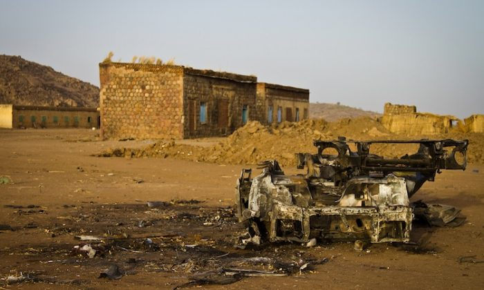 Photo taken on April 3, shows the shell of a vehicle that was hit by a bomb in the abandoned village of Trogi during fighting in South Kordofan, Sudan. (Adriane Ohanesian/AFP/Getty Images)