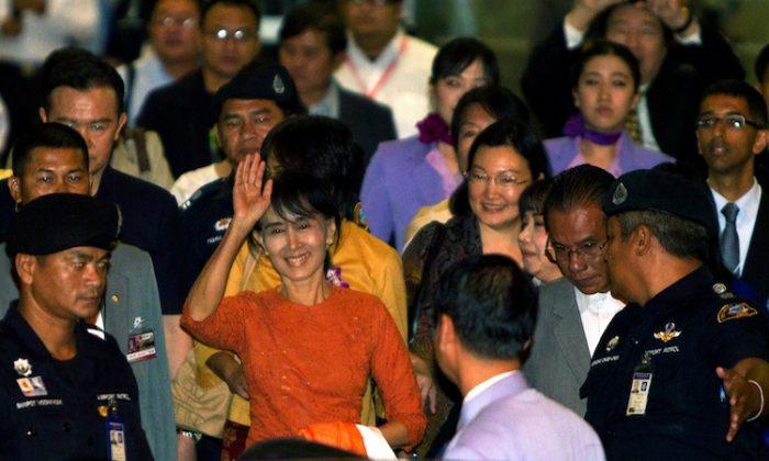 Burmese pro-democracy leader Aung San Suu Kyi leaves the Suvarnabhumi International Airport on her first international trip in 24 years outside Burma May 29, in Bangkok, Thailand. (Paula Bronstein/Getty Images)