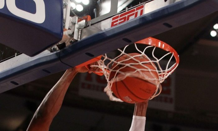 Syracuse center Fab Melo slams home two of his seven points. He also added six rebounds. (Jim McIsaac/Getty Images)