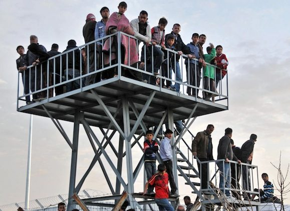 Syrian refugees watch the border from Oncupinar Refugee Camp on April 9, in Kilis. Two other Syrians and a Turkish translator were wounded near a refugee camp in the same area when shots were fired from Syria. (IHA/AFP/Getty Images)