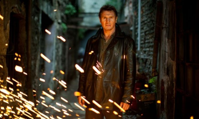 "Liam Neeson, playing Bryan Mills, prepares for a fiery confrontation with a band of killers in ""Taken 2."" (Magali Bragard/ Grive Productions)"