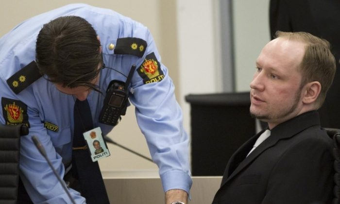 Right-wing extremist Anders Behring Breivik's handcuffs are removed in an Oslo courtroom on April 20. On day five of his trail for mass murder, Breivik gave a detailed account of his shooting rampage on Utoeya Island on July 22, 2011. (Daniel Sannum Lauten/AFP/Getty Images)