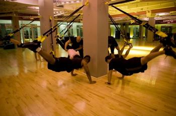 TRX provides a wide array of new and challenging exercises, speeding up your workout and your results.  (Courtesy of Fitness Anywhere)