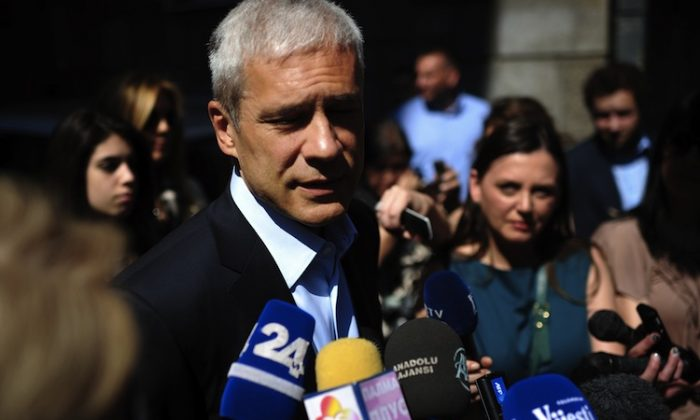 Serbian incumbent President Boris Tadic and leader of the Democratic Party (DS) speaks to the media after voting at a polling station in Belgrade on May 6. (Dimitar Dilkoff/AFP/GettyImages)